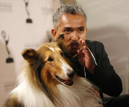 Cesar Millan poses with Lassie at 2008 Primetime Creative Arts Awards in Los Angeles