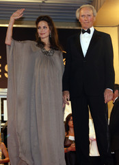"Cast member Jolie waves with US director Eastwood after the screening of ""The Exchange"" in Cannes"