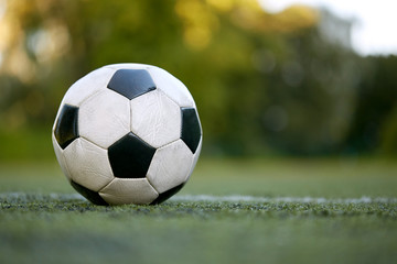 soccer ball on football field marking line