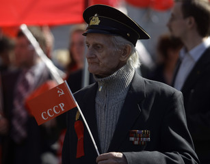 A communist attends a march to mark May Day in St. Petersburg