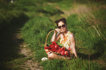 Beautiful woman with bouquet of flowers outdoors