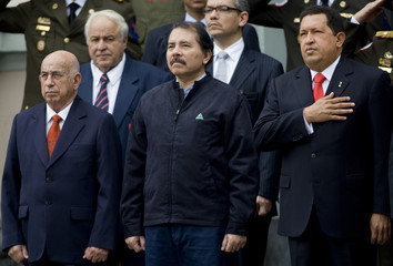 Venezuela's President Chavez, Nicaragua's President Ortega and Cuba's Vice-President Machado Ventura stand at the gates of the National Pantheon in Caracas