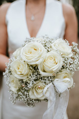 bride holding white boquet