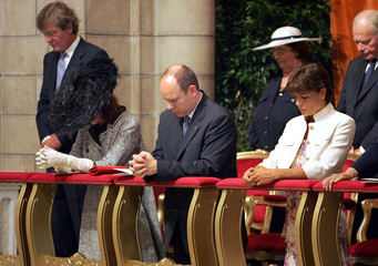 Prince Albert II of Monaco and his sisters Caroline and Stephanie attend a mass on day Prince is to ...
