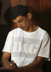 Mohamed D'Ali Carvalho Santos looks on during his trial in Goiania