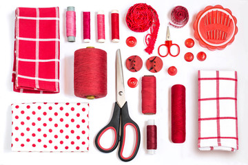 Various sewing accessories and tools red shades