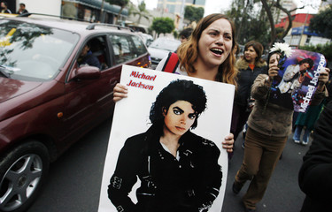 A fan of Michael Jackson cries in the street before a tribute in Lima