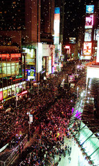 CROWDS GATHER IN NEW YORK'S TIMES SQUARE FOR NEW YEARS CELEBRATION.