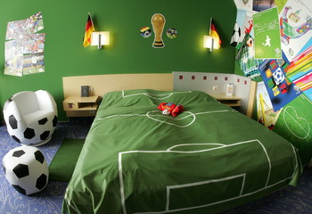 Picture shows a guest room decorated with soccer accessories at a hotel in Neumuenster about 60 km (..