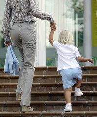 Spain's Princess Letizia and daughter Infanta Sofia walk up stairs to her nursery outside Madrid