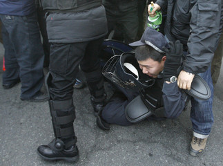 Protesters scuffle with police as policemen block their march during a rally in Seoul