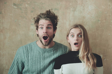 Wow! Surprised man and woman with open mouth, young couple