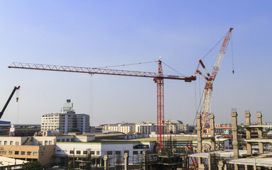 Construction site with many construction cranes.