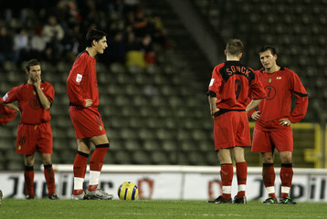 Belgium's players react after a World Cup qualifier against Serbia and Montenegro in Brussels.