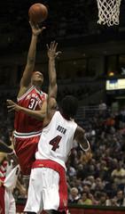 Milwaukee Bucks forward Charlie Villanueva is fouled by Toronto Raptors forward Chris Bosh