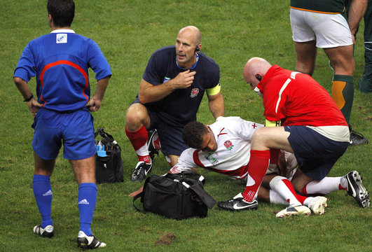 England's Jason Robinson reacts to his leg muscle injury during the Group A Rugby World Cup match against South Africa at the Stade de France Stadium