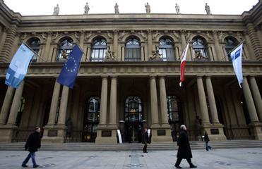 Pedestrians walk by Germany's stock exchange Deutsche Boerse Group in Frankfurt.
