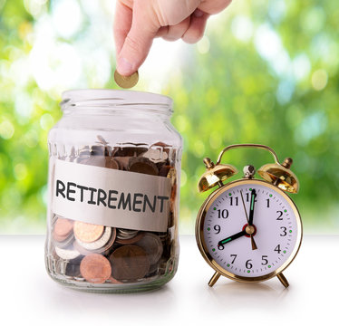 Coins in glass jar for retirement