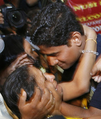 Unidentified family members of freed hostage Patil welcome him on his arrival in Mumbai