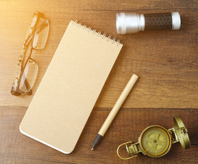 Travel and vacation background with items on wooden