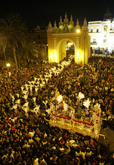"""People gather to watch a procession of """"La Macarena"""" brotherhood in Seville"""
