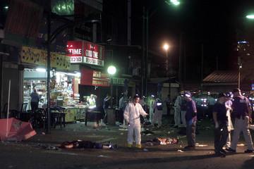 ISRAELI INVESTIGATORS CHECK AREA NEAR BODIES AT THE SCENE OF SUICIDEBOMBING IN TEL AVIV.