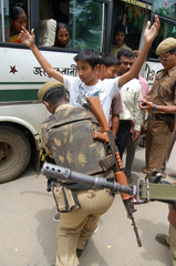 Indian security personnel search commuters in Guwahati in the northeastern Indian state of Assam