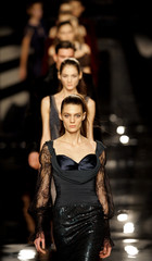 Models display outfits by Victorio & Lucchino at Madrid fashion show