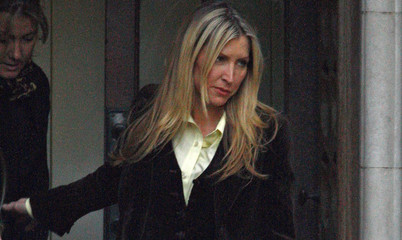 Britain's Heather Mills leaves the High Court in London
