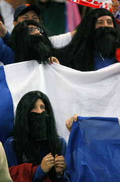 France team fans of Sebastien Chabal wear long hair and beards as they attend the Group D Rugby World Cup match against Ireland