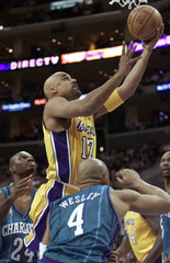 LAKERS FOX SCORES PAST HORNETS MASHBURN AND WESLEY.