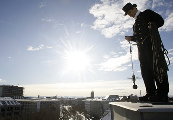 Chimney sweeper Udo Voigt prepares to clean the chimney on a roof of a house in downtown Munich