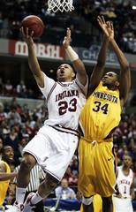 Eric Gordon scores against Damian Johnson in Indianapolis