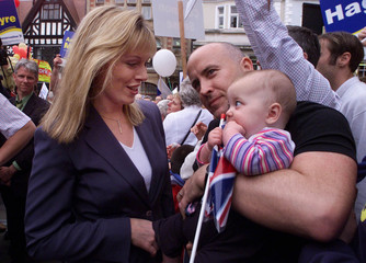 FFION HAGUE MEETS A BABY DURING CAMPAIGNING IN SHREWSBURY WITH HER HUSBAND.