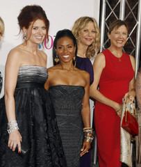 "Debra Messing and cast pose at the premiere of the film ""The Women"" in Los Angeles"
