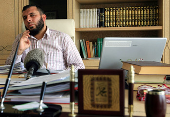 Karahan, Turkish lawyer of suspected al Qaeda militant on trial in Turkey, talks during an interview in his office in Istanbul