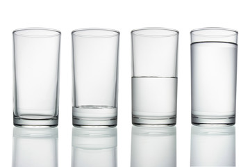 .tall empty, half and full glass of water isolated on white with clipping path included