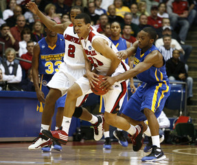 University of Louisville forward Jared Swopshire is pressured by Morehead State forward Maze Stallworth during their first round NCAA tournament basketball game in Dayton