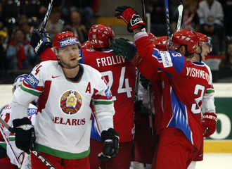 Russia's players celebrate a goal next to Belarus' Salei during their IIHF World Hockey Championship quarterfinal game in Bern