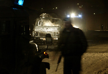 Israeli forces guard a car containing a suspect package which was destroyed at Kalandia checkpoint ...