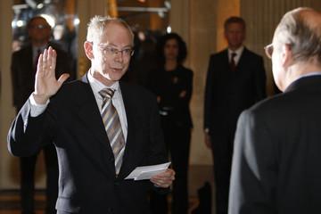 Van Rompuy is sworn in as Belgium's Prime Minister in the presence of Belgian King Albert II in Brussels