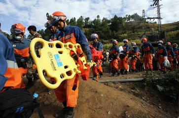 Members of the Japan Disaster Relief team reach the town of Bata Mora