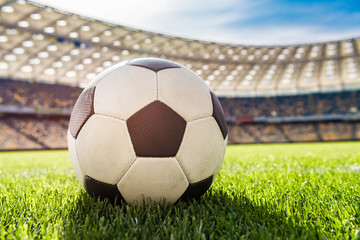 close up view of soccer ball on grass on soccer field stadium