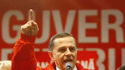 Romania's opposition Social Democrat Party leader Geoana gestures during a speech after first exit polls in Bucharest