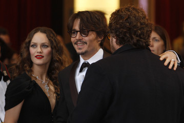 Singer Paradis, with best actor nominee Johnny Depp and best director nominee Julian Schnabel talk on the red carpet at the 80th annual Academy Awar