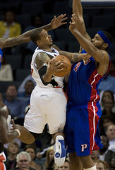 Charlotte Bobcats' Brown looks to pass ball around Detroit Pistons' Wallace in Charlotte