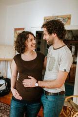 pregnant couple laughing