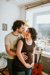 pregnant couple at home