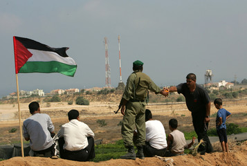 Member of Palestinian security forces is deployed near Jewish settlement in the north of Gaza Strip.