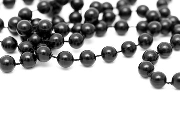 Black beads on a white background